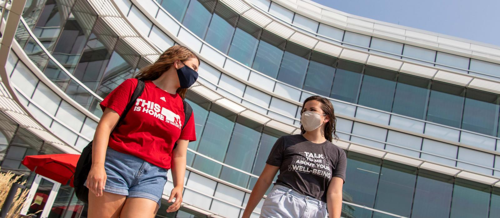 Big Red Resilience and Well-being students and coaches wear face coverings and walk outside
