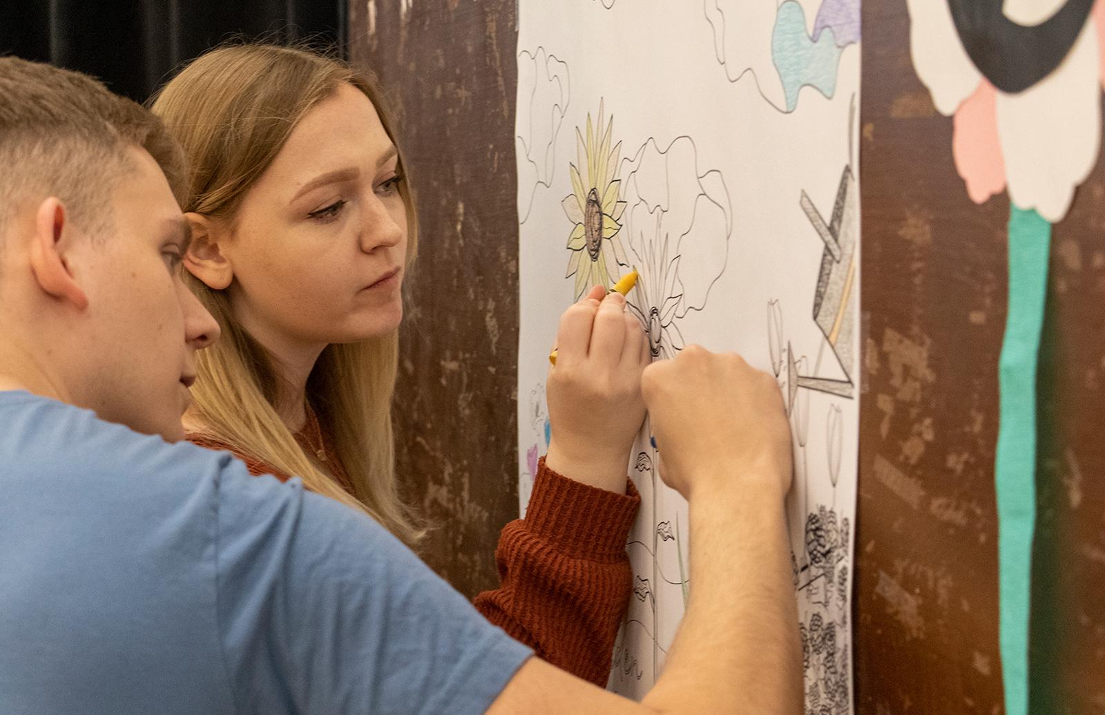 Man and woman drawing at Fresh Check Day