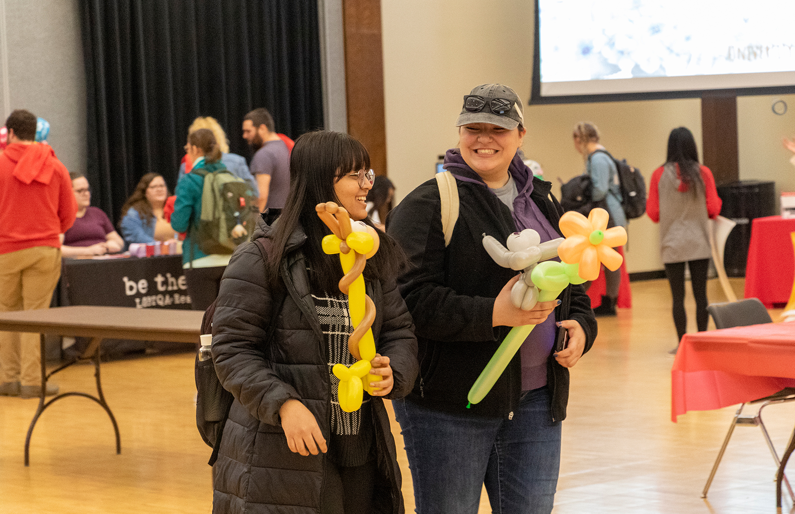 Women carrying balloon animals at Fresh Check Day