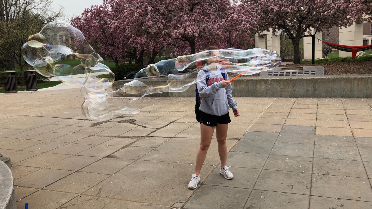 A Nebraska student blows bubbles as a relaxation exercise during finals week.