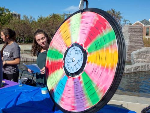 Woman playing a wheel game at recess