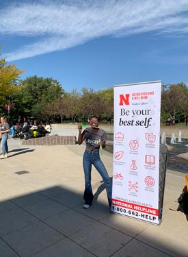 Woman displaying a poster at recess
