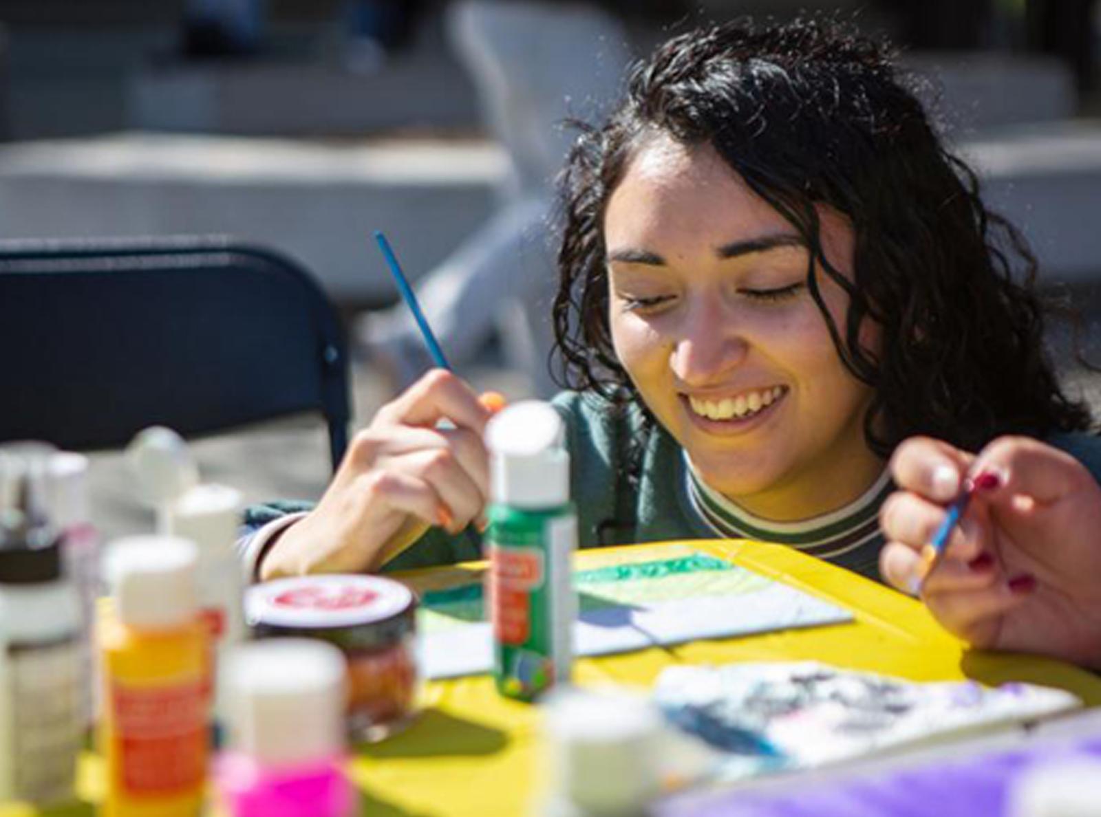 Woman paints at recess